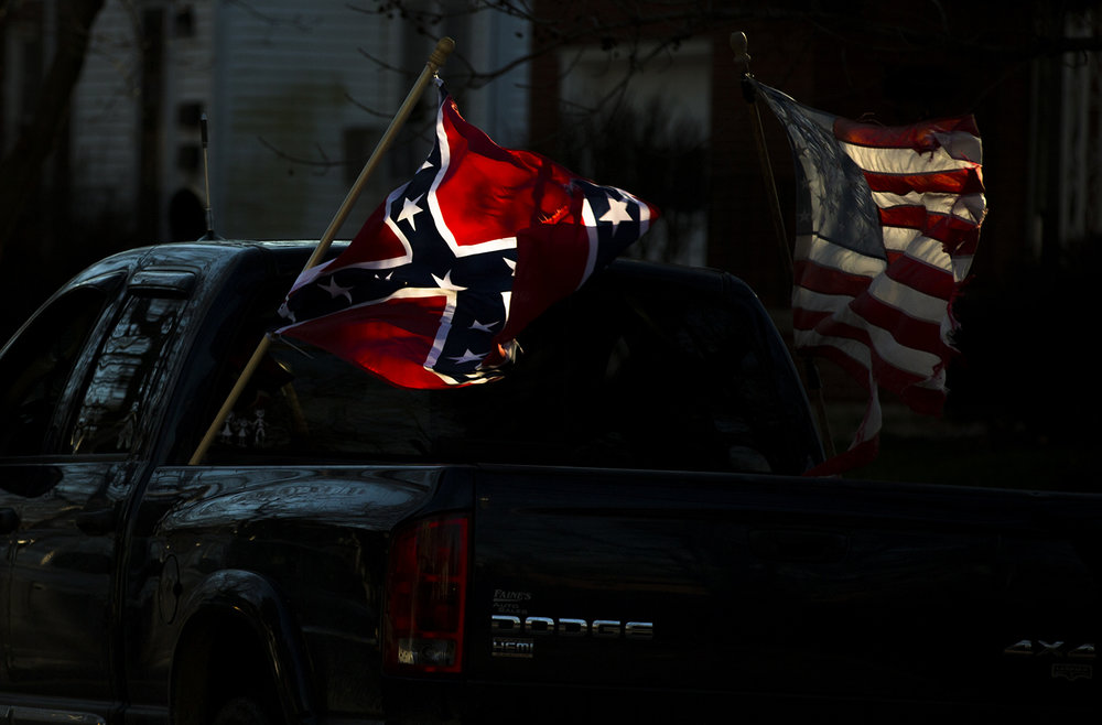 A flag of the Confederate states is displayed with the American flag on a pickup truck in Springfield Thursday, Jan. 14, 2016.  Justin L. Fowler/The State Journal-Register