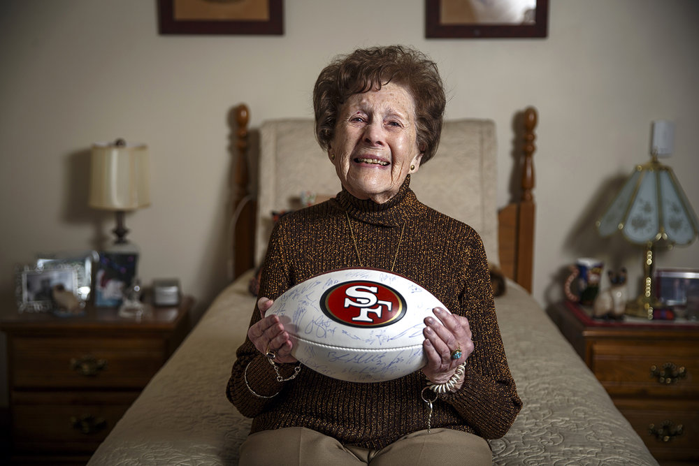 Georgia Schultz, 92, a resident of St. Joseph's Home, has a San Francisco 49er football that has the signatures of the entire 2015 team that was given to her by her friend, Denise DeBartolo York, the 49ers' owner.  Justin L. Fowler/The State Journal-Register