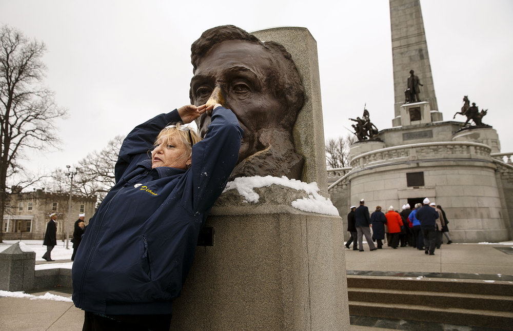 Diane Cetera of Chicago rubs the nose on Lincoln's statue for the first time in her life during the Pilgrimage to Lincoln's Tomb at Oak Ridge Cemetery Friday, Feb. 12, 2016. The event, now in its 82nd year, is held in honor of the 16th president by the veterans group.  Ted Schurter/The State Journal-Register