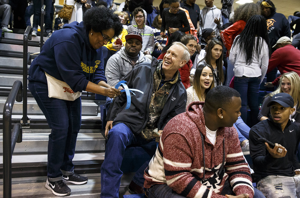 Illinois Gov. Bruce Rauner buys a 50/50 ticket from Diana Seawood during the Lanphier vs. Southeast game at Herb Scheffler Gymnasium, Friday, Feb. 26, 2016.  Justin L. Fowler/The State Journal-Register