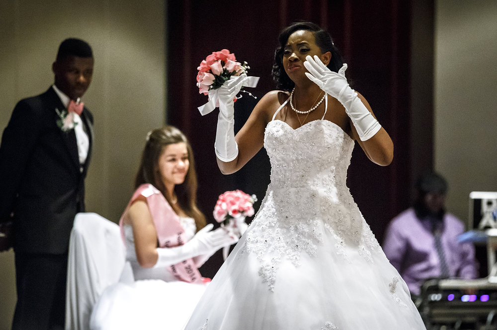 Jada Rice holds back the tears after being named Miss Fashionetta 2016 during Alpha Kappa Alpha Sorority Nu Omicron Omega Chapter's 18th Annual Debutante Cotillion Fashionetta 2016 at the Crowne Plaza Hotel, Saturday, March 26, 2016.  Justin L. Fowler/The State Journal-Register