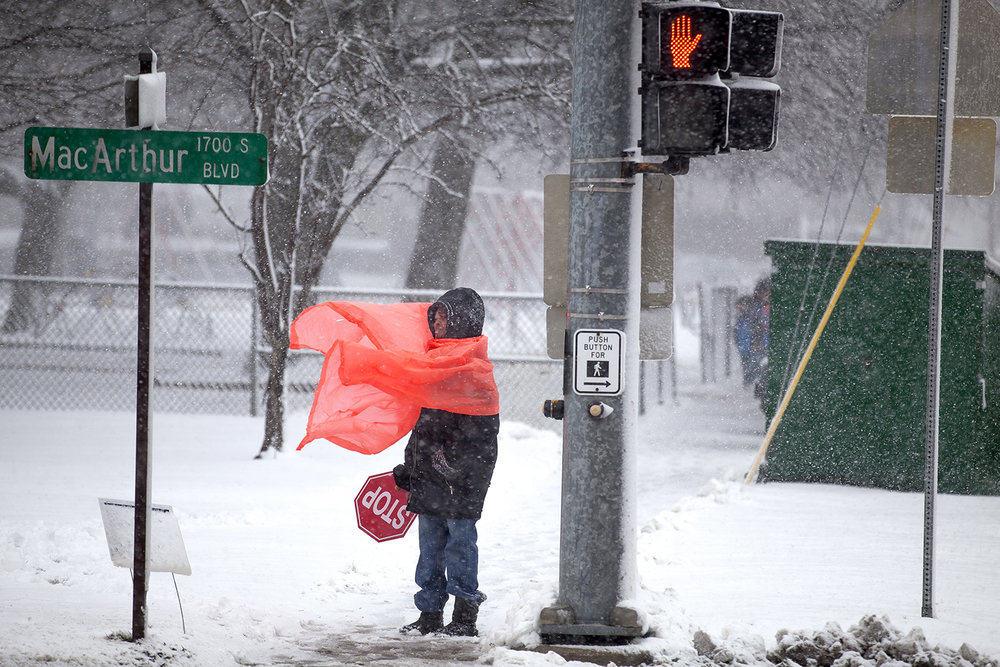 Eleanor Stemmons is buffeted by wind and snow while on duty as a school crossing guard at MacArthur Boulevard and Laurel Street Wednesday, Feb. 24, 2016.  Rich Saal/The State Journal-Register