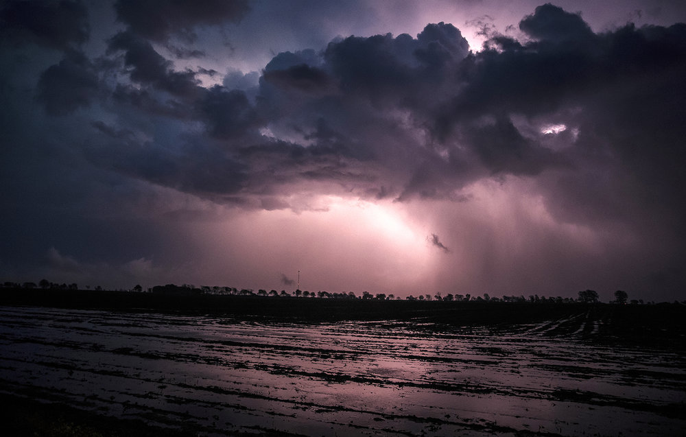 Lightning illuminates the clouds over a flooded field south of Owaneco as a storm dissipates Wednesday, April 27, 2016.  Justin L. Fowler/The State Journal-Register