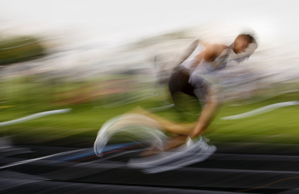 Sacred Heart-Griffin's Tristan Blair becomes a blur of color and in a long exposure photograph from the start of the 400-meter dash at the Boys City Track Meet at Memorial Stadium Tuesday, May 3, 2016.  Ted Schurter/The State Journal-Register