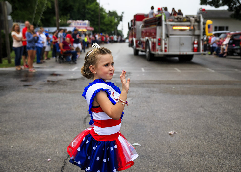 Gracee Geer, 5, 2016 Little Miss Franklin, waves to fire engines as they parade through the center of town during the Franklin Fourth parade July 4, 2016.  Justin L. Fowler/The State Journal-Register