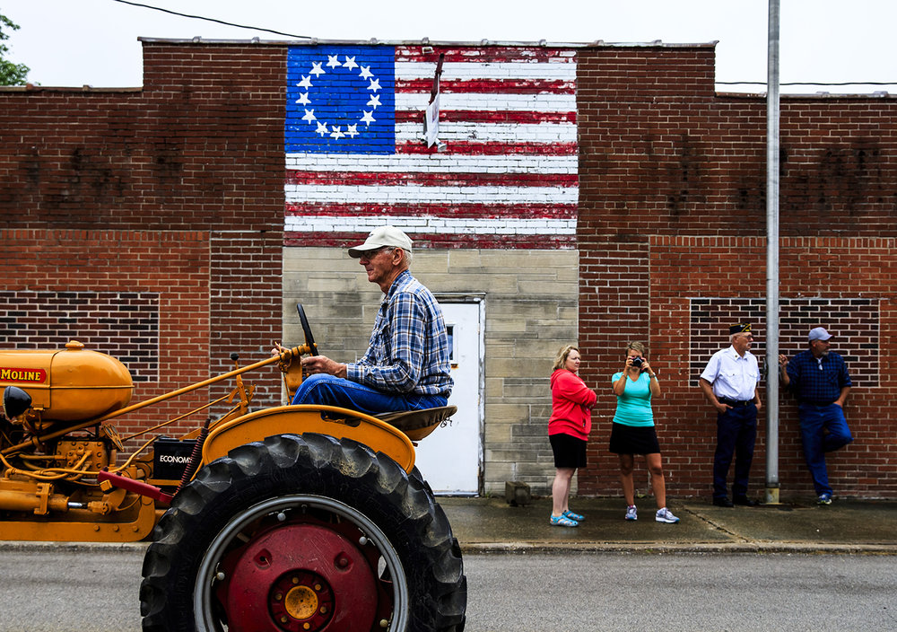 The antique tractors pass the American Legion Past 1089 as they make their way home after the Franklin Fourth parade, Monday, July 4, 2016.  Justin L. Fowler/The State Journal-Register