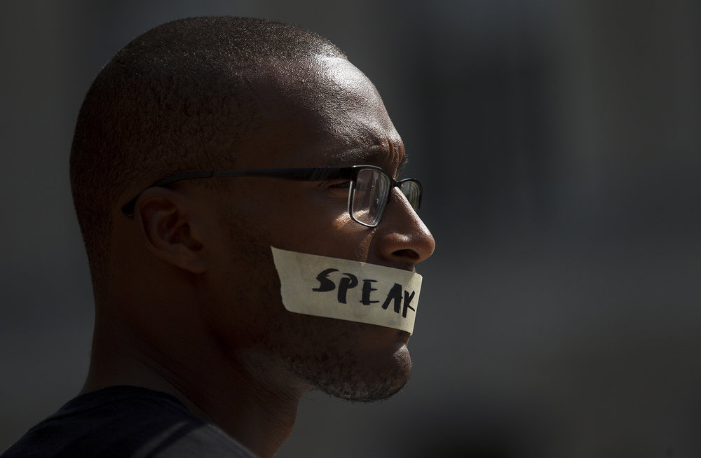Leroy Newbon Jr. wears tape over his mouth during the Black Lives Matter rally at the Capitol Saturday, July 9, 2016.  Ted Schurter/The State Journal-Register