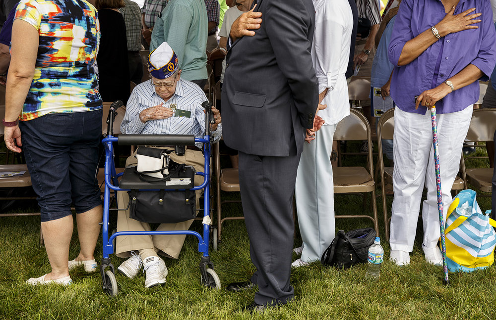 World War II veteran Rayburn Martin puts his hand over his heart during the playing of Taps following a dedication ceremony for the new Purple Heart Memorial at Oak Ridge Cemetery Sunday, Aug. 7, 2016. Martin was wounded on Omaha Beach on D-Day, June 6, 1944. He recovered and was returned to his outfit just in time to fight in the Battle of the Bulge. Martin earned the Bronze Star, the Purple Heart and a medal for the Battle of the Bulge.  Ted Schurter/The State Journal-Register