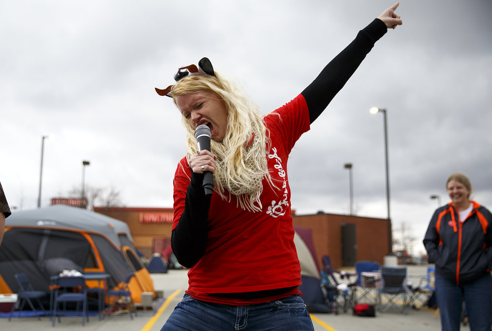 For the love of a chicken sandwich, Amber Johnson puts everything into her Elvis impersonation during activities organized by Chick-fil-A employees for people camped outside their new store at White Oaks Mall Wednesday, March 9, 2016. People began lining up before 6 a.m. to be one of the first 100 customers when they open, for which they get a free meal every week for a year.  Rich Saal/The State Journal-Register