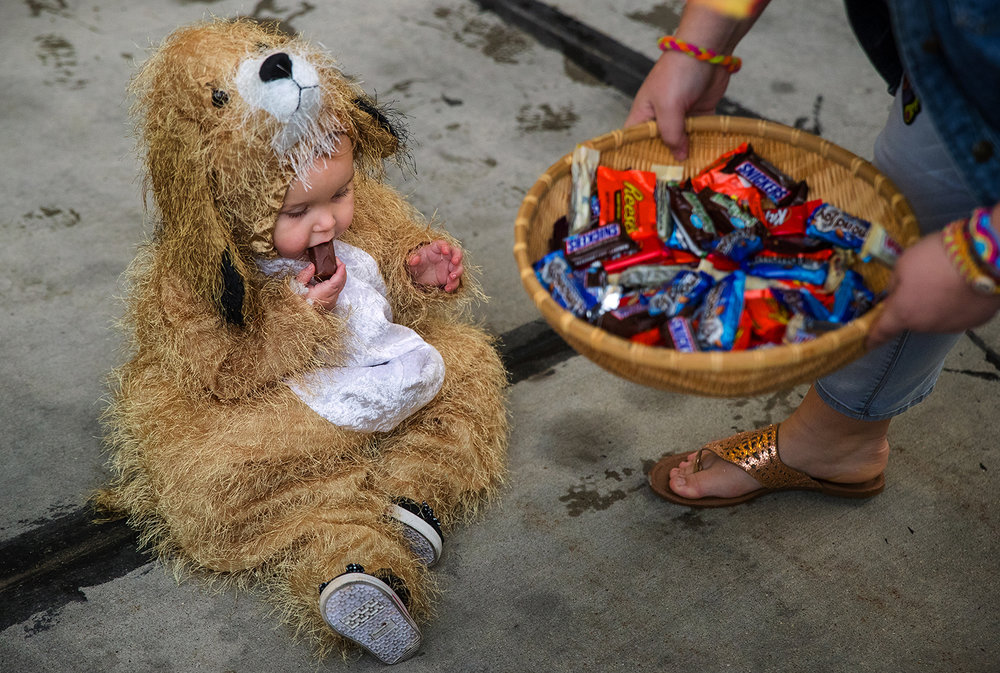 Alaina Winslow samples some of the candy offered to her during a joint annual Halloween Safety Event coordinated by the Springfield Police and Fire Departments at Fire Station 1, 825 East Capitol Ave. Thursday, October 27, 2016.  Ted Schurter/The State Journal-Register