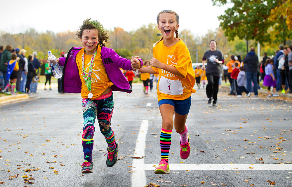 "Madigan Burger, left, and Ellen Ehrman stride to the finish during the Girls on the Run ""Be Your Own Super Hero"" 5k on the campus of Lincoln Land Community College Saturday, Nov. 5, 2016. The run is the culmination of a 10-week program which focuses on teaching self-respect and healthy lifestyle choices.  Ted Schurter/The State Journal-Register"