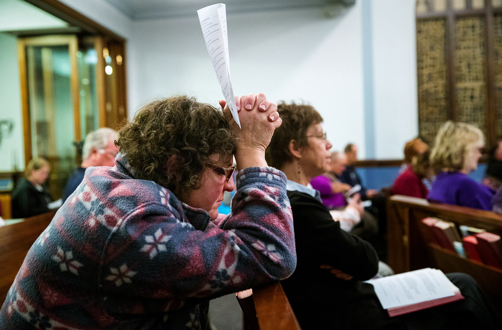 "Corinna Kurth Baker prays during a nonpartisan, post-election prayer service at Laurel United Methodist Church Wednesday, Nov. 9, 2016. Event organizers said they hoped to refocus people's attention on ""words that are inclusive, that respect differences among people.""  Ted Schurter/The State Journal-Register"