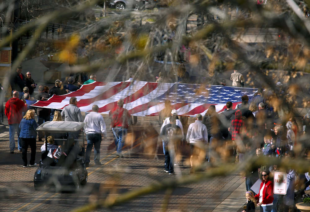 An American flag presented by Springfield Elks Lodge 158, makes it way down Capitol Avenue during the Veterans Day parade Friday, Nov. 11, 2016.  Rich Saal/The State Journal-Register