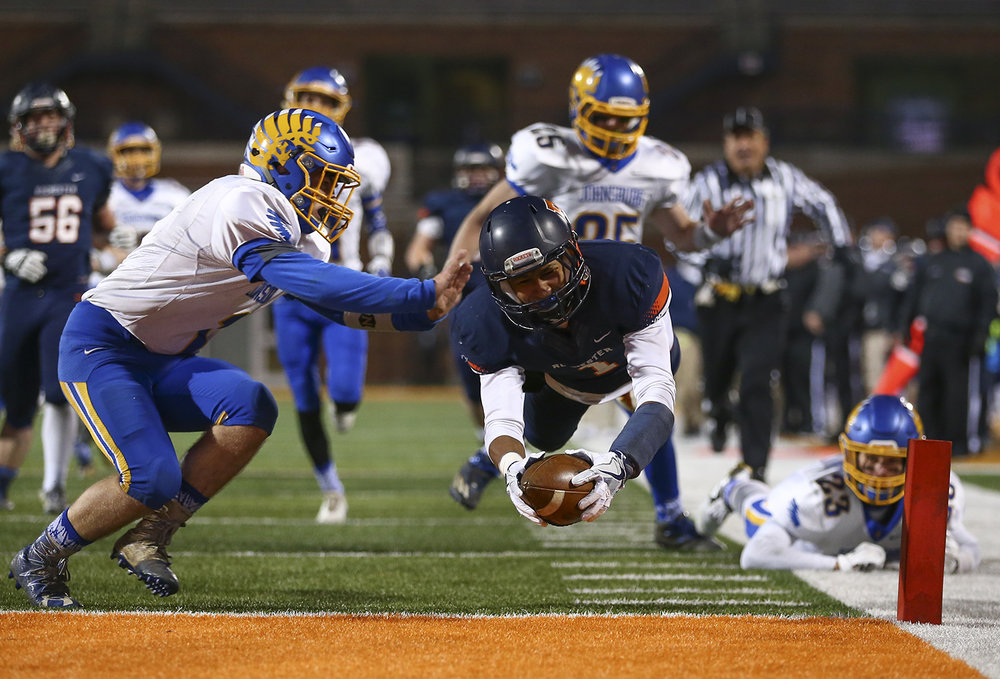 Rochester's D'Ante Cox dives for the end zone and a touchdown against Johnsburg's Blake Lemke in the second quarter of the IHSA Class 4A State Championship at Memorial Stadium, Friday, Nov. 25, 2016, in Champaign. The Rockets won the title game, their sixth in seven years.  Justin L. Fowler/The State Journal-Register