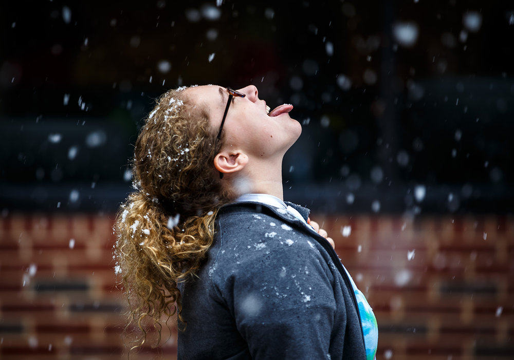 Alexa Diser of Belleville tries to catch snowflakes during the first snowfall of the season outside of Menard Hall on the campus of Lincoln Land Community College, Sunday, Dec. 4, 2016.  Justin L. Fowler/The State Journal-Register