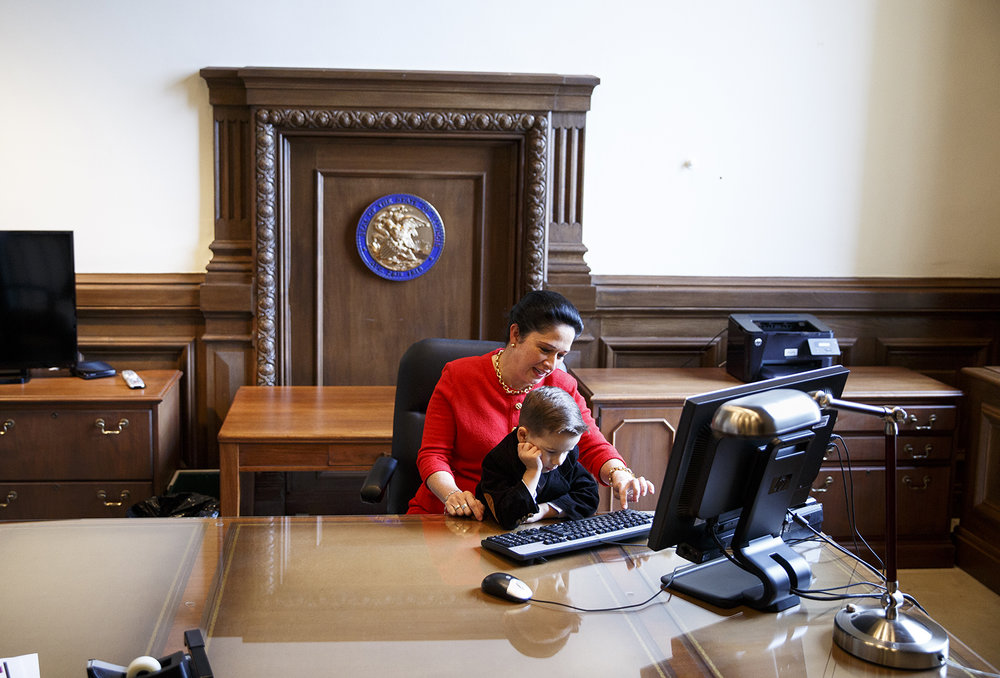 Susana Mendoza sits with her son, David Quinten, 5, at the desk in her new office at the Capitol after she was sworn in as comptroller Monday, Dec. 5, 2016. Mendoza, a Democrat, last month beat Leslie Munger in a special election. Munger had been appointed by Gov. Bruce Rauner to succeed Judy Baar Topinka, who died in 2014.  Rich Saal/The State Journal-Register