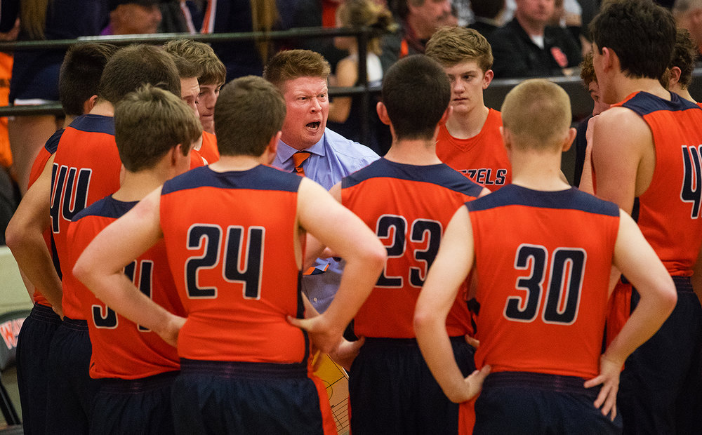 New Berlin head coach yells at his team during a first half timeout as they face Athens during the Waverly Holiday Tournament Championship game Thursday, Dec. 29, 2016. Ted Schurter/The State Journal-Register