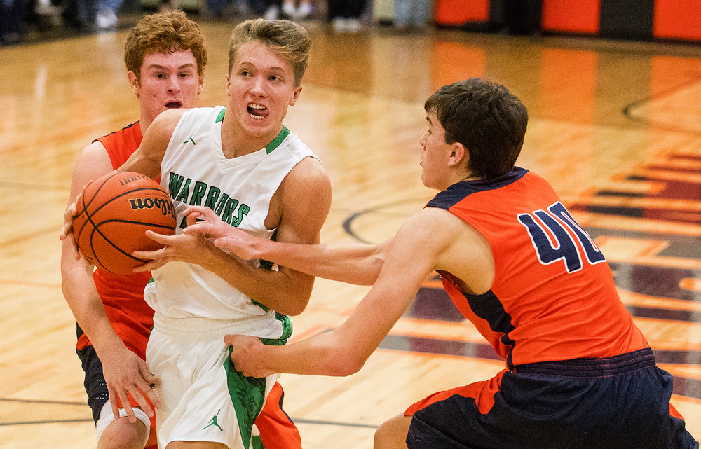 Athens' Aaron Schober drives past New Berlin's Hunter Stockton, left, and Max Day during the Waverly Holiday Tournament Championship game Thursday, Dec. 29, 2016. Ted Schurter/The State Journal-Register
