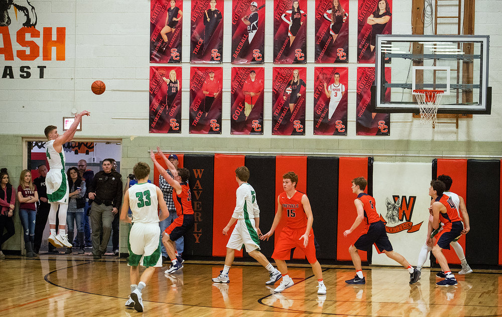 Athens' Hunter Maxwell fires a three pointer against New Berlin during the Waverly Holiday Tournament Championship game Thursday, Dec. 29, 2016. Ted Schurter/The State Journal-Register