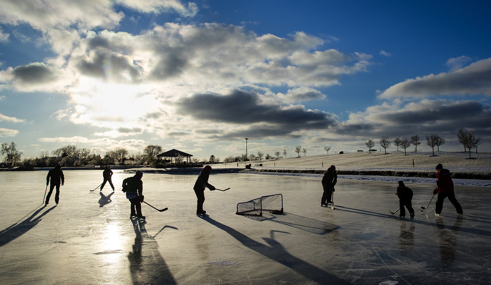 A group of hockey enthusiasts play a pick-up game on the ice at Southwind Park Sunday, Dec. 18, 2016. Despite the sunshine, temperatures stayed in the siingle digits Ted Schurter/The State Journal-Register