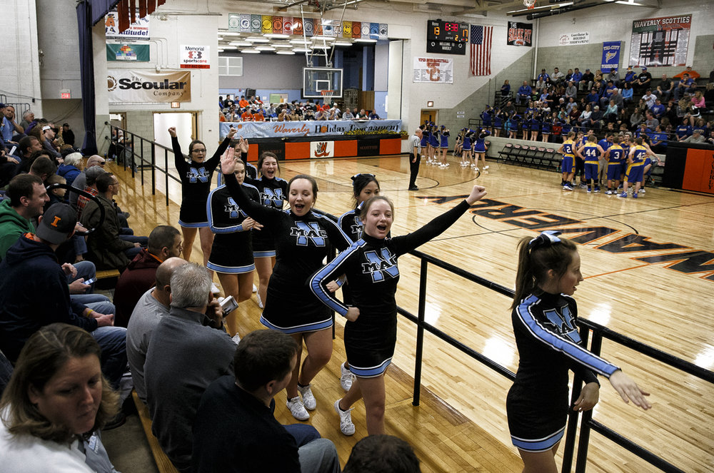 The North Mac cheerleaders head into the stands to cheer on the Panthers and their fans as they take on Tri-City during the 66th annual Waverly Holiday Basketball Tournament at Waverly Elementary School, Monday, Dec. 26, 2016, in Waverly, Ill. Justin L. Fowler/The State Journal-Register