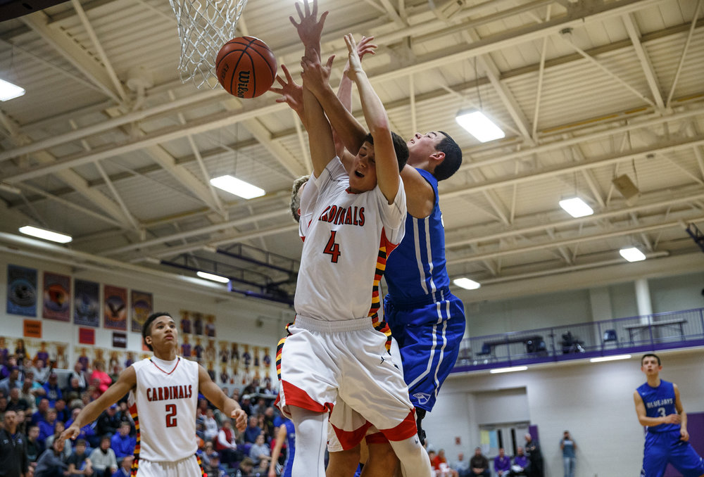 Warrensburg-Latham's Alex Coers (4) goes for a rebound against PORTA's Tyler Minor (33) in the third quarter during the 23rd annual Williamsville Holiday Tournament at David J. Root Court, Tuesday, Dec. 27, 2016, in Williamsville, Ill. Justin L. Fowler/The State Journal-Register