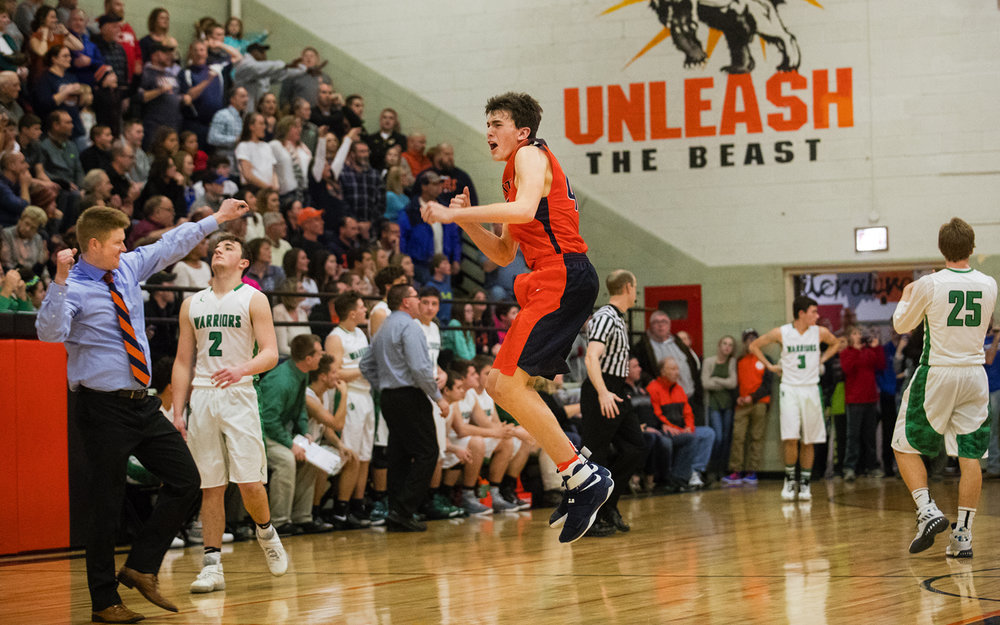 New Berlin's Max Day leaps into the air as head coach Blake Lucas celebrates after defeating Athens 34-33 during the Waverly Holiday Tournament Championship Thursday, Dec. 29, 2016. Ted Schurter/The State Journal-Register