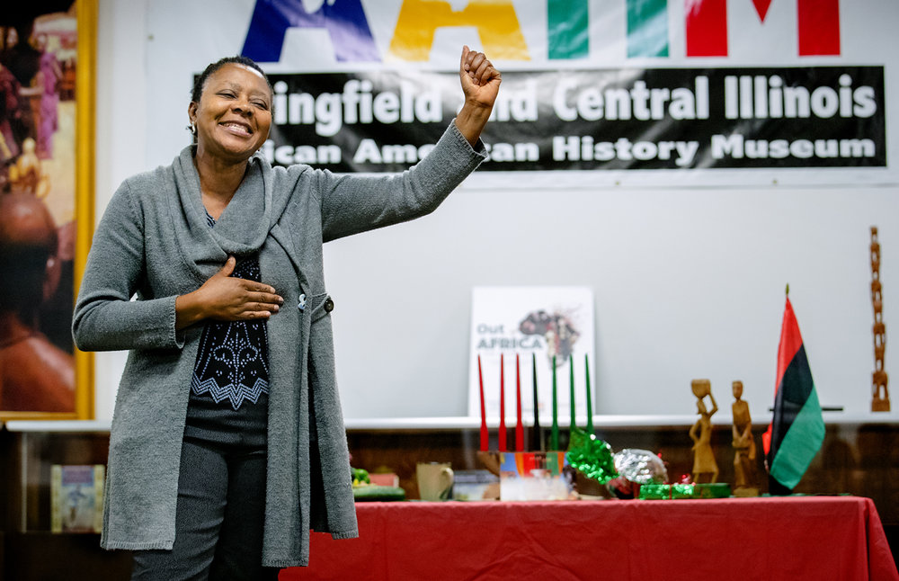 "Frida Fokum sings ""Nkosi Sikele iAfrika,"" translated God Bless Africa, in Zulu during a Kwanzaa celebration at the Springfield and Central Illinois African American History Museum Friday, Dec. 30, 2016. Kwanzaa comes from the Swahili phrase ""matunda ya kwanza,"" meaning ""first fruits of the harvest."" It's a seven-day observance that begins Dec. 26 and runs through Jan. 1. During each day of the celebration, one of seven principles is observed. The seven principles are: unity, self-determination, collective work and responsibility, cooperative economics, purpose, creativity and faith. Ted Schurter/The State Journal-Register"