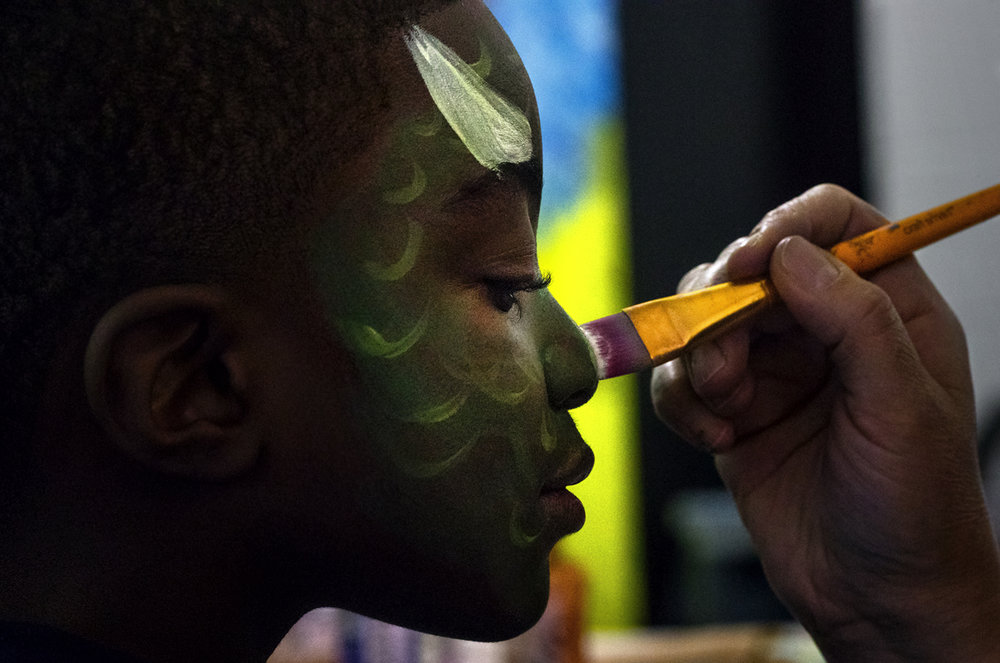 Rashad Young closes his eyes as a face paint artist transforms his face into a triceratops during First Night Springfield activities at Springfield High School Saturday, Dec. 31, 2016. Ted Schurter/The State Journal-Register