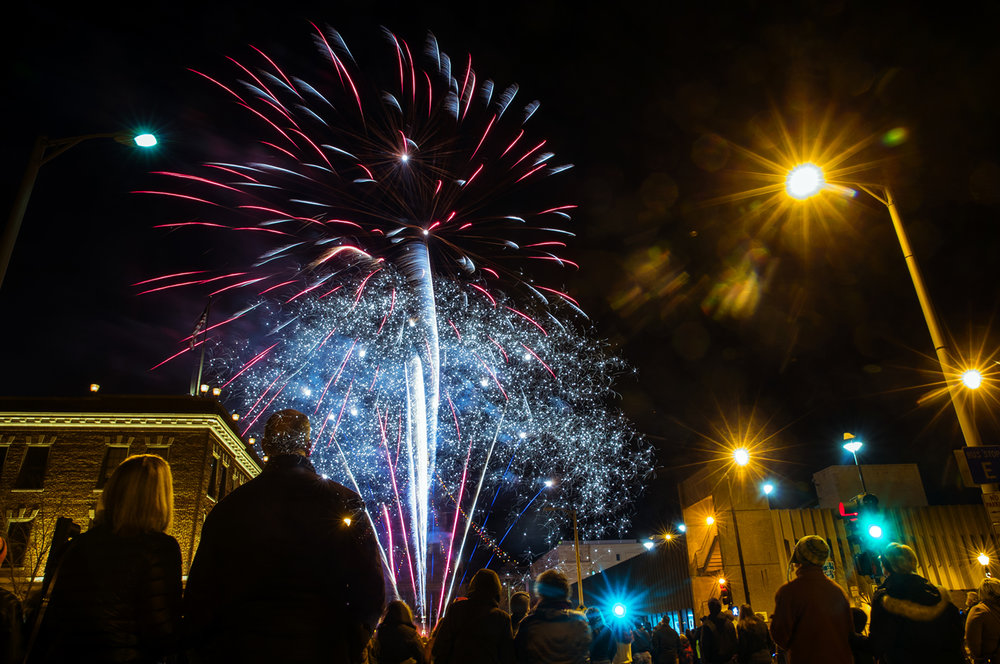 A crowd watches as fireworks erupt over Capitol Avenue during First Night Springfield at the Hoogland Center for the Arts Saturday, Dec. 31, 2016. Ted Schurter/The State Journal-Register