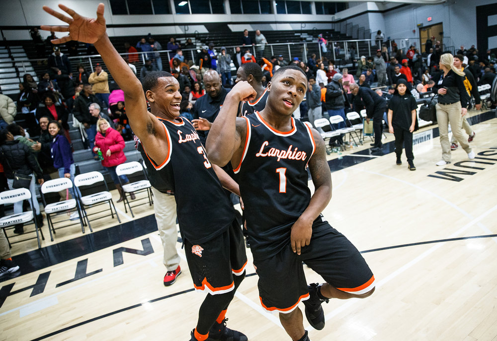 Lanphier's Yaakema Rose (1) and Lanphier's Aundrae Williams (3) celebrate their victory over Decatur Eisenhower at Eisenhower High School, Friday, Jan. 6, 2017, in Decatur, Ill. Justin L. Fowler/The State Journal-Register