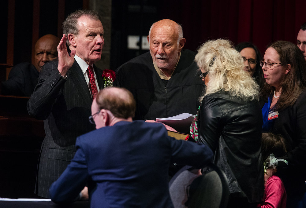 Alan J. Greiman, a retired judge of the Illinois First District Appellate Court, administers the oath of office for Illinois House Speaker Michael Madigan, D-Chicago, during the inauguration ceremony for the 100th Illinois General Assembly at Sangamon Auditorium at the University of Illinois Springfield Wednesday, Jan. 11, 2017. Ted Schurter/The State Journal-Register