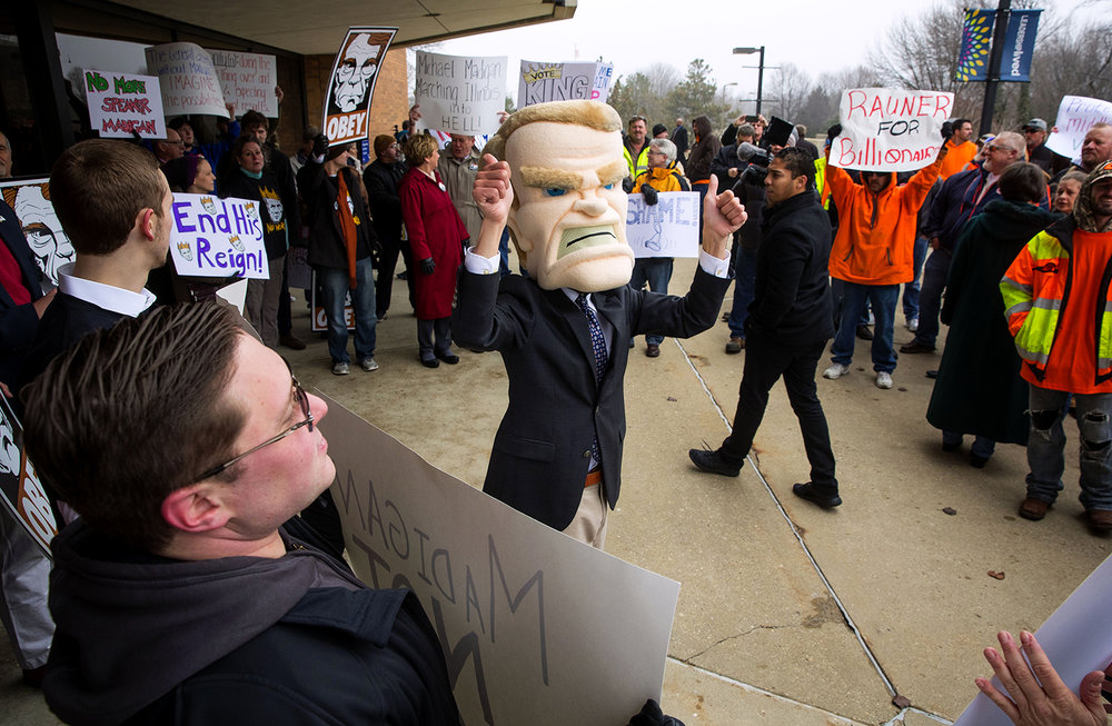 A protest organized by Illinois Policy featuring an Illinois House Speaker Michael Madigan mascot was met by counter protesters supporting Madigan and protesting Illinois gov. Bruce Rauner before the inauguration ceremony for the 100th Illinois General Assembly at Sangamon Auditorium at the University of Illinois Springfield Wednesday, Jan. 11, 2017. Ted Schurter/The State Journal-Register