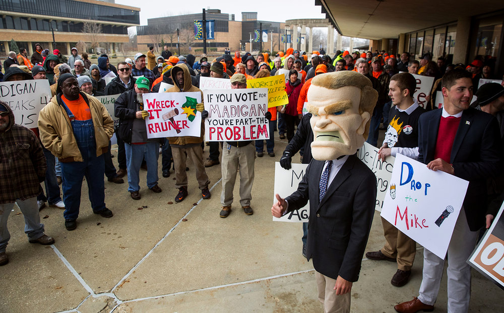 Participants at a protest organized by Illinois Policy that included a mascot of Illinois Speaker of the House Mike Madigan were met and surrounded by counter protesters supporting Madigan and protesting Illinois Gov. Bruce Rauner before the inauguration ceremony  for the 100th Illinois General Assembly at Sangamon Auditorium at the University of Illinois Springfield Wednesday, Jan. 11, 2017. Ted Schurter/The State Journal-Register