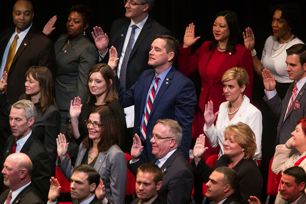 Avery Bourne, R-Raymond, Tim Butler, R-Springfield, and Sara Wojcicki Jimenez, R-Leland Grove, take the oath of office during the inauguration ceremony  for the 100th Illinois General Assembly at Sangamon Auditorium at the University of Illinois Springfield Wednesday, Jan. 11, 2017. Ted Schurter/The State Journal-Register