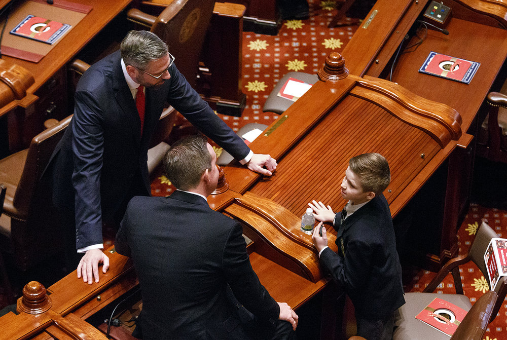 State Treasurer Michael Frerichs, left, visits with Sen. Andy Manar, D-Bunker Hill, and his son, Will, before the start of the inauguration of the Senate as part of the 100th Illinois General Assembly at the Capitol Wednesday, Jan. 11, 2016. Rich Saal/The State Journal-Register