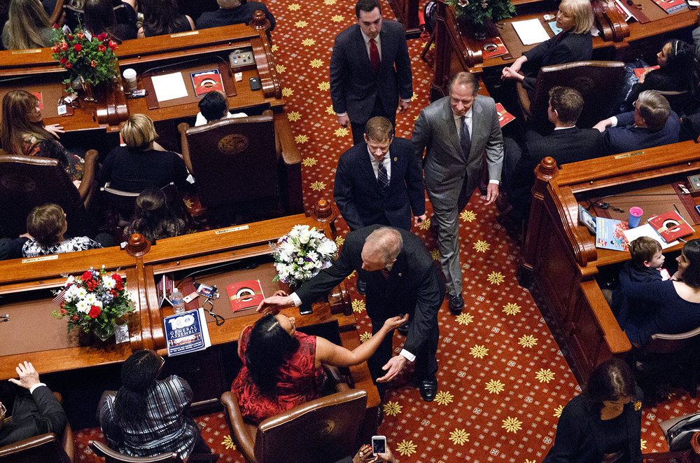 Gov. Bruce Rauner pauses to greet Sen. Toi Hutchinson, D-Chicago Heights, on his way out of the Senate chamber following inauguration of the Senate as part of the 100th Illinois General Assembly at the Capitol Wednesday, Jan. 11, 2017. Rich Saal/The State Journal-Register
