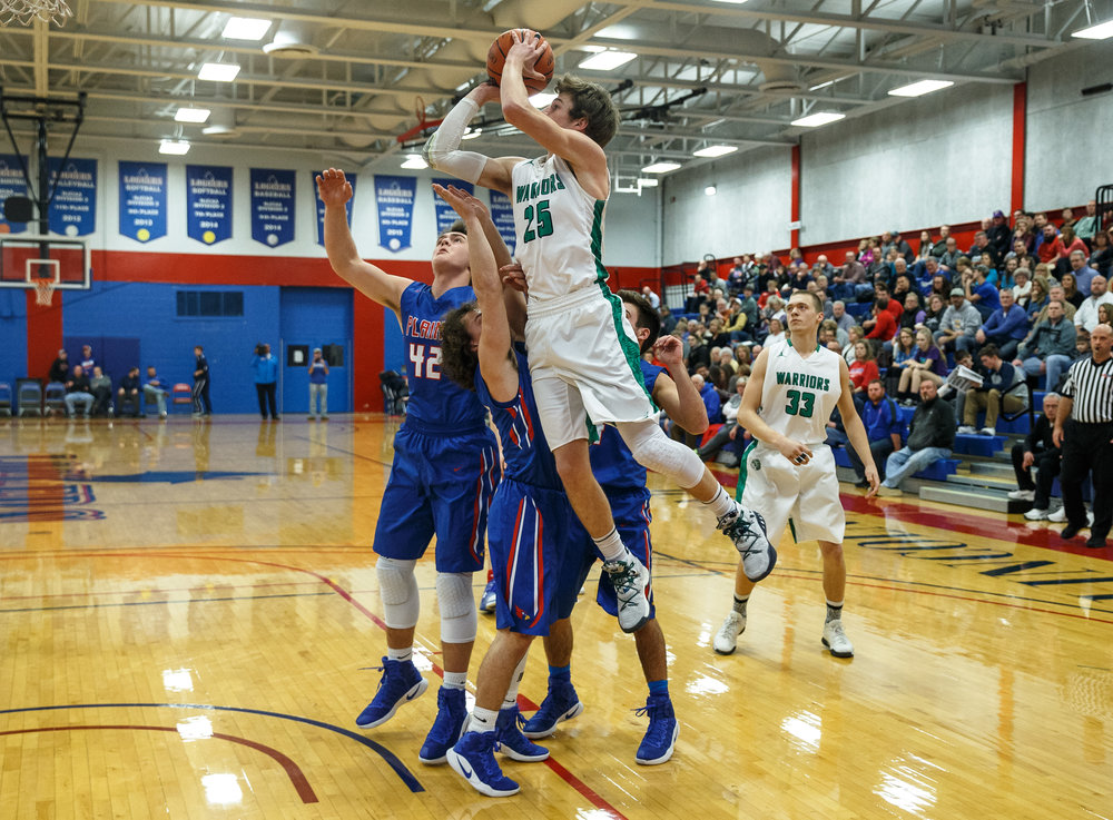 Athens' Drayton Davis (25) puts up a shot against Pleasant Plains' Cole Greer (13) during the Sangamon County Tournament at Cass Gymnasium, Thursday, Jan. 12, 2017, in Springfield, Ill. Justin L. Fowler/The State Journal-Register