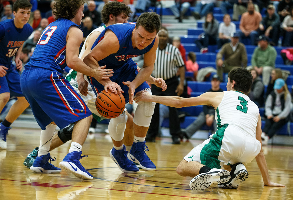 Pleasant Plains' Nik Clemens (42) grabs a loose ball against Athens' Layne Hill (3) in the first half during the Sangamon County Tournament at Cass Gymnasium, Thursday, Jan. 12, 2017, in Springfield, Ill. Justin L. Fowler/The State Journal-Register