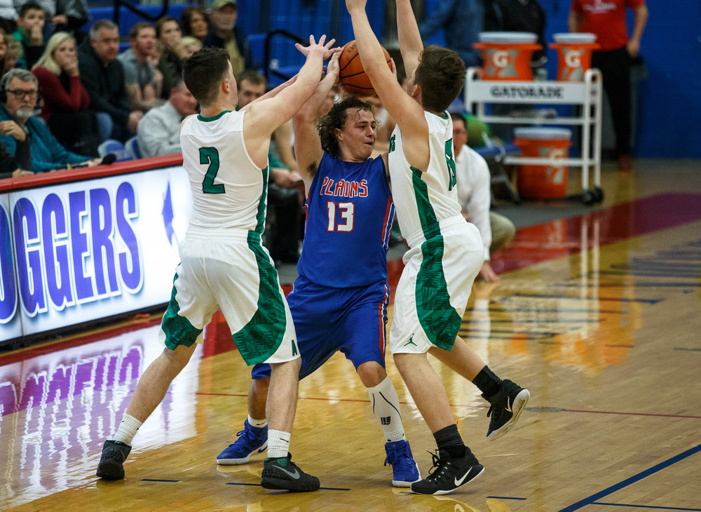 Pleasant Plains' Cole Greer (13) is swarmed by Athens' Nick Hanner (2) and Athens' Nic Laird (13) in the second half during the Sangamon County Tournament at Cass Gymnasium, Thursday, Jan. 12, 2017, in Springfield, Ill. Justin L. Fowler/The State Journal-Register