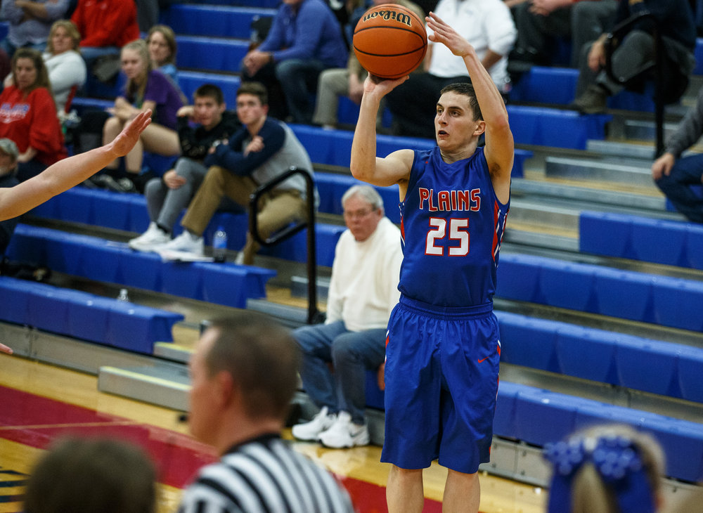Pleasant Plains' Isaac Collins (25) drains a three pointer against Athens in the second half during the Sangamon County Tournament at Cass Gymnasium, Thursday, Jan. 12, 2017, in Springfield, Ill. Justin L. Fowler/The State Journal-Register