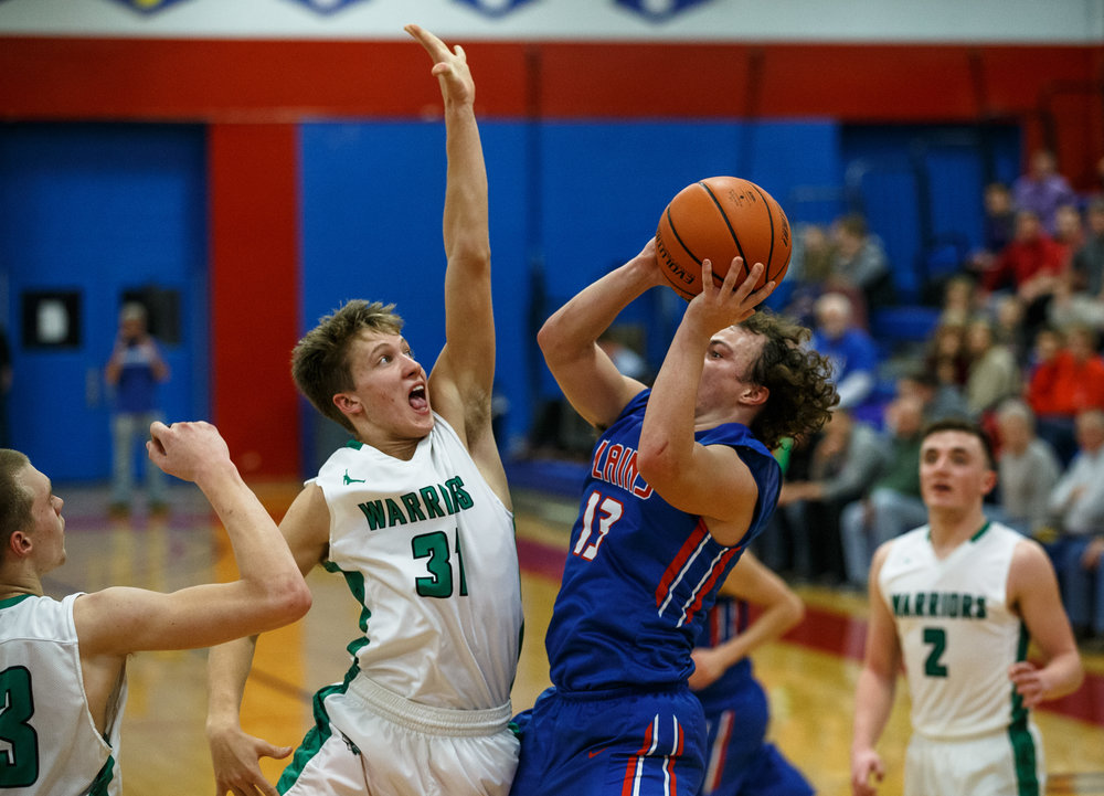 Athens' Aaron Schober (31) tries to disrupt a shot attempt from Pleasant Plains' Cole Greer (13) in the second half during the Sangamon County Tournament at Cass Gymnasium, Thursday, Jan. 12, 2017, in Springfield, Ill. Justin L. Fowler/The State Journal-Register