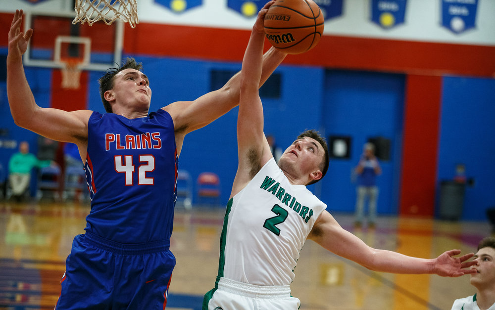 Pleasant Plains' Nik Clemens (42) and Athens' Nick Hanner (2) battle for a rebound in the second half during the Sangamon County Tournament at Cass Gymnasium, Thursday, Jan. 12, 2017, in Springfield, Ill. Justin L. Fowler/The State Journal-Register