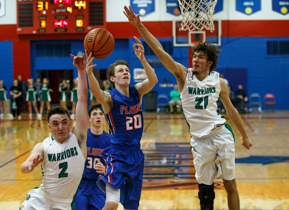 Pleasant Plains' Nick Savage (20) goes up for a shot against Athens' Nick Hanner (2) and Athens' Garrett Reichart (21) in the second half during the Sangamon County Tournament at Cass Gymnasium, Thursday, Jan. 12, 2017, in Springfield, Ill. Justin L. Fowler/The State Journal-Register