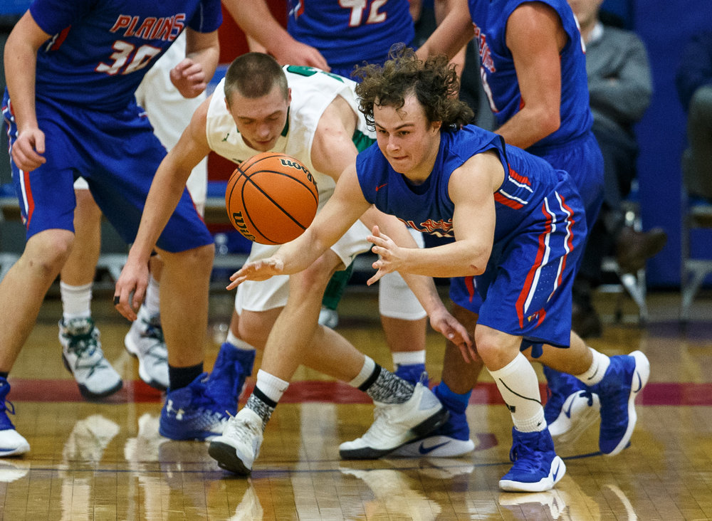 Pleasant Plains' Cole Greer (13) steals the ball away in front of Athens' Devin Richardson (33) in the second half during the Sangamon County Tournament at Cass Gymnasium, Thursday, Jan. 12, 2017, in Springfield, Ill. Justin L. Fowler/The State Journal-Register