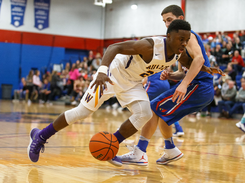 Williamsville's Daetayvian Woodson (23) looses control of the ball as he drives against Pleasant Plains' Isaac Collins (25) in the first half during the championship game of the Sangamon County Tournament at Cass Gymnasium, Friday, Jan. 13, 2017, in Springfield, Ill. Justin L. Fowler/The State Journal-Register