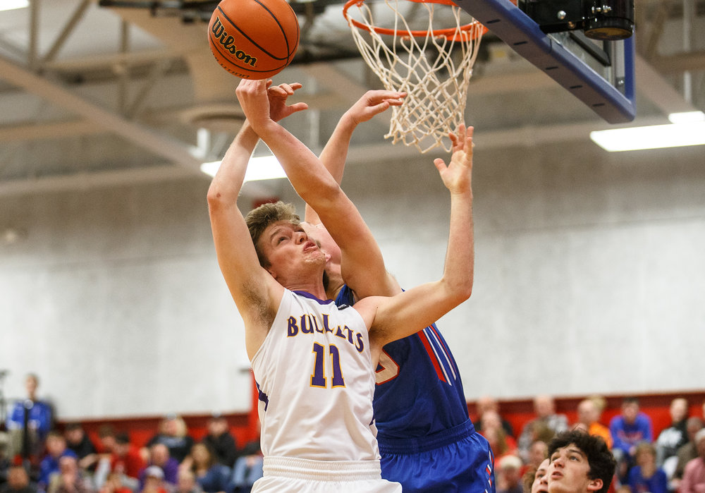 Williamsville's Jacob Sexton (11) and Pleasant Plains' Joel Niermann (30) go for a rebound in the first half during the championship game of the Sangamon County Tournament at Cass Gymnasium, Friday, Jan. 13, 2017, in Springfield, Ill. Justin L. Fowler/The State Journal-Register