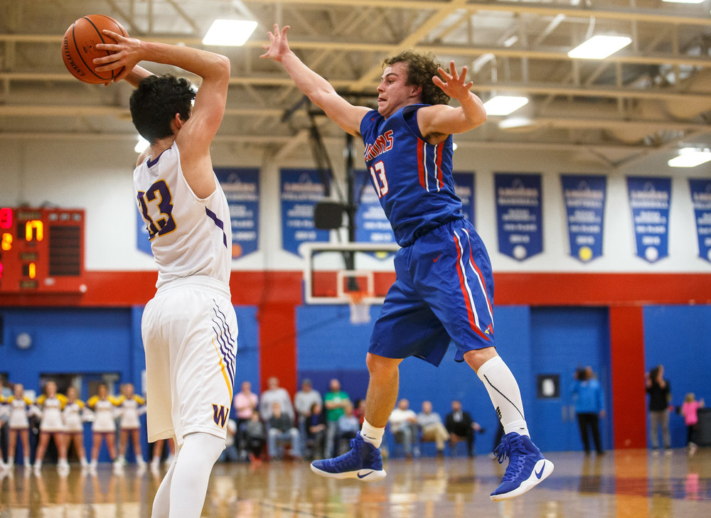 Pleasant Plains' Cole Greer (13) tries to block a pass from Williamsville's Jake Pennell (33) in the first half during the championship game of the Sangamon County Tournament at Cass Gymnasium, Friday, Jan. 13, 2017, in Springfield, Ill. Justin L. Fowler/The State Journal-Register