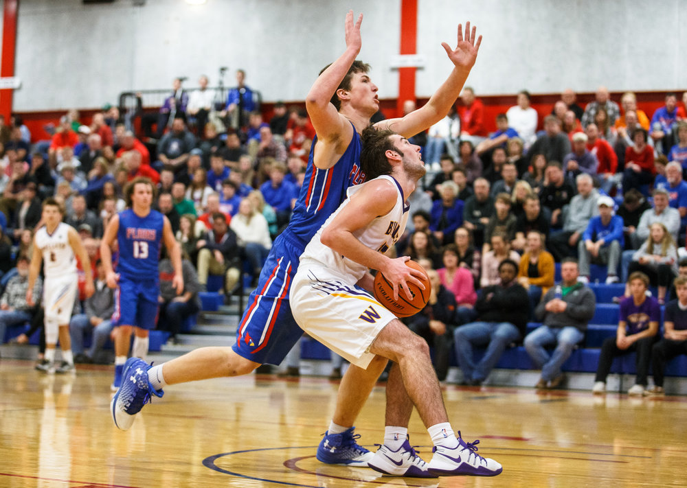 Pleasant Plains' Joel Niermann (30) is called for foul trying to guard Williamsville's Joseph Mitchell (13) underneath the basket in the first half during the championship game of the Sangamon County Tournament at  Cass Gymnasium, Friday, Jan. 13, 2017, in Springfield, Ill. Justin L. Fowler/The State Journal-Register