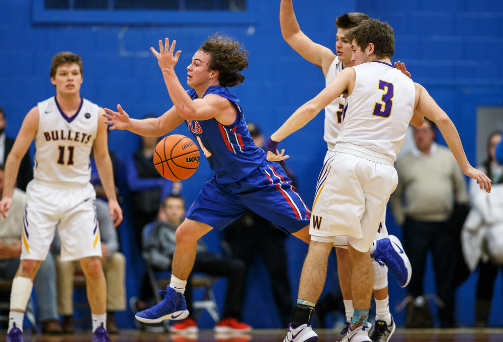 Pleasant Plains' Cole Greer (13) looses control o fate ball as he drives towards the basket against Williamsville's Brandon Bunger (3) in the first half during the championship game of the Sangamon County Tournament at Cass Gymnasium, Friday, Jan. 13, 2017, in Springfield, Ill. Justin L. Fowler/The State Journal-Register
